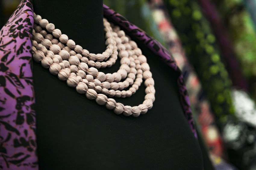 Close up. a chain decoration for women Art And Craft Close-up Craft Creativity Day Design Floral Pattern Focus On Foreground Hanging Jewelry Nature No People Outdoors Pattern Personal Accessory Pink Color Plant Purple Rope Selective Focus Textile