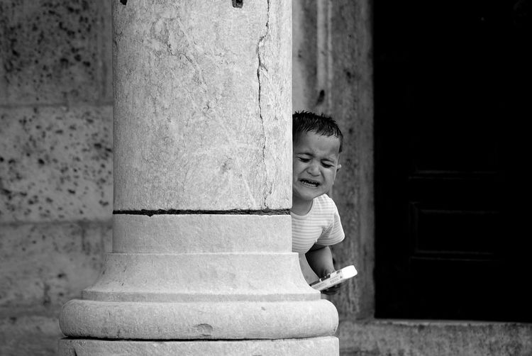a Syrian boy in Konya. he started to cry when her sisters went away.he was screaming for help...Streetphotography Streetphoto_bw Monochrome EyeEm Best Shots - Black + White The Human Condition Blackandwhite Bw_collection Portrait Blackandwhite Photography Telling Stories Differently
