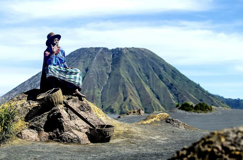 The Photojournalist - 2015 EyeEm Awards A Tengger Salesman is having a Rest in Tengger Seasand with Bromo background meanwhile having a Ciggarette . Eastjava INDONESIA