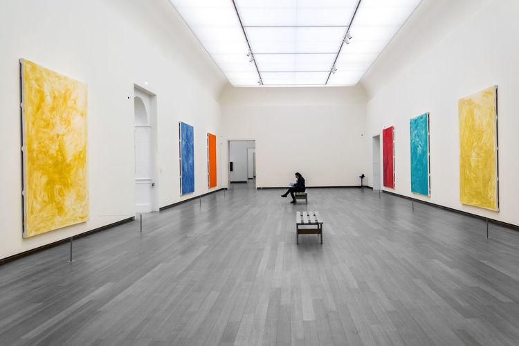Man walking in corridor of museum