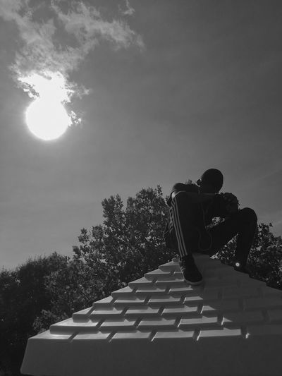 Up high, feeling low Tree Absence Sunny Tranquil Scene Tranquility Memories Sky Relaxation Outdoors Sun Solitude Scenics Remote Cloud - Sky Young Adult Causal Clothing Portrait Blackandwhite Shadow Sun Light Trees