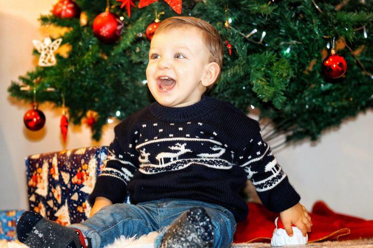 Full length of boy against christmas tree