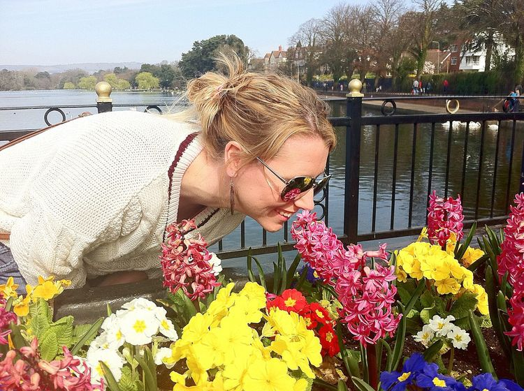 Stop to sniff the primroses Flower Plant Growth Leisure Activity Beauty In Nature Outdoors Nature Day Sky Water One Person One Woman Only Only Women Freshness Bouquet Adult People Wales UK Wales Cardiff Roathlake Roathpark Roath Nature Scenics