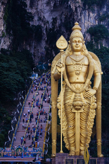 Low angle view of lord murugan statue at batu caves
