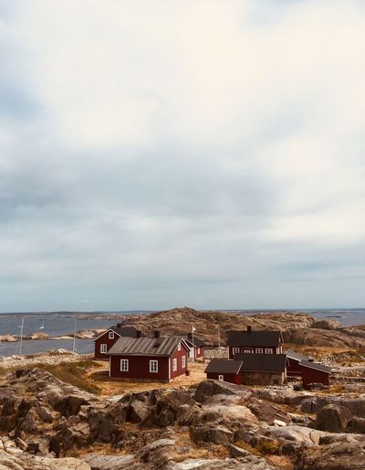 The island of Ursholmen close to the Koster islands. Copy Space House Houses Remote Idyllic Red Swedish West Coast Coast Archipelago Rocks Island Cottages Cottage Swedish Ursholmen Cloud - Sky Sky Sea Water Architecture Land Nature Horizon Horizon Over Water Scenics - Nature Built Structure Day Beauty In Nature