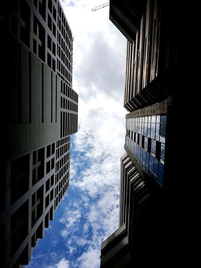 Low angle view of office building against sky