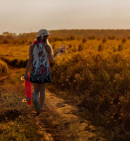 Russia Sunset Rear View Walking Nature One Person Field Full Length Leisure Activity Landscape Lifestyles Hiking Outdoors Grass Real People Women Adventure Beauty In Nature Young Adult Day Sky