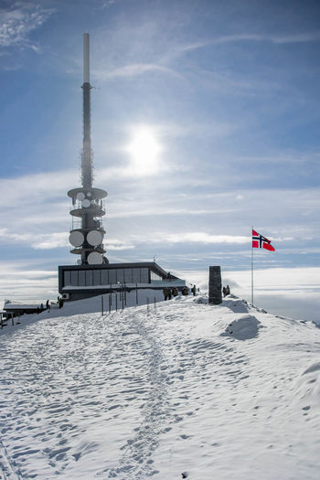 The communications tower atop Mount Ulriekn, Bergen, Norway. Bergen Ice Norway Ulriken Winter Beauty In Nature Cold Temperature Flag Mountain Outdoors Seasons Shadows Snow Sunshine Tower