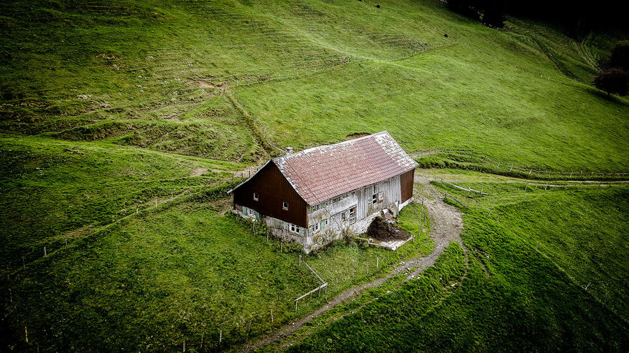High angle view of abandoned house on field