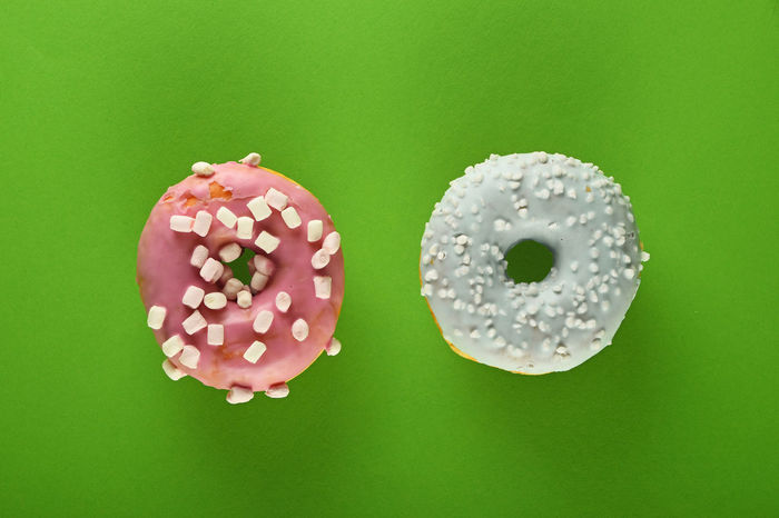 Two donuts with sprinkles and marshmallows Baked Bakery Blue Choice Choose Donut Donuts Doughnut Doughnuts Food Geometry Glazed Green Background Marshmallow Marshmallows Pink Round Sprinkles Sweet Sweets The OO Mission Two Unhealthy Eating Colour Of Life