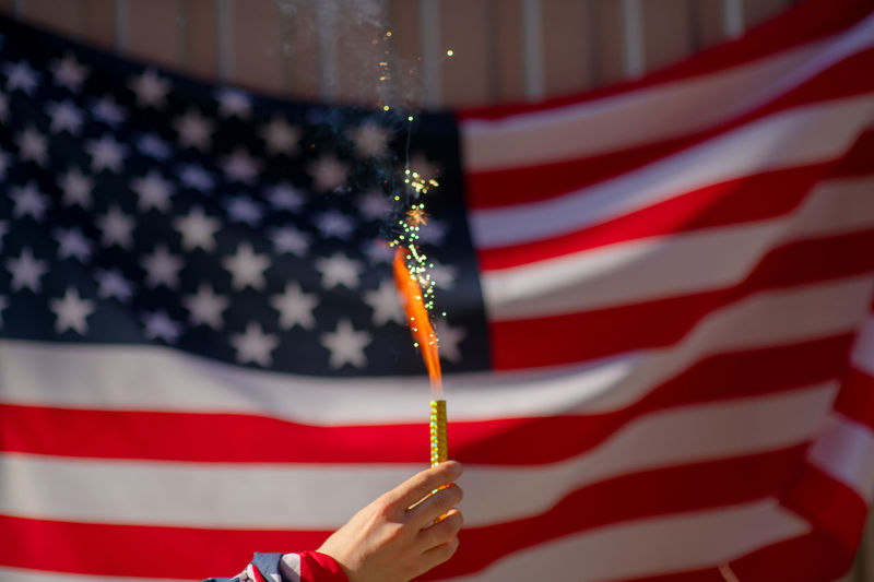 USA flag Flag Patriotism Star Shape Striped Human Hand Shape Red People Holding Human Body Part Focus On Foreground Hand Real People Celebration Pride Close-up Unrecognizable Person Finger Government