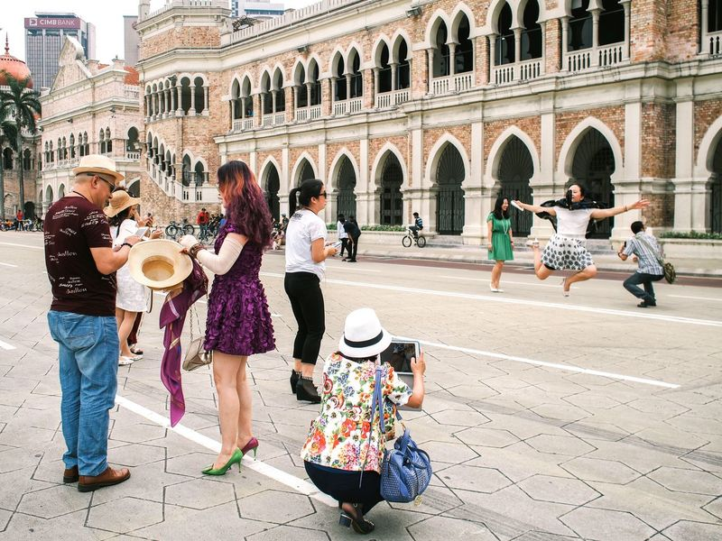 Tourist in action Taking Photos Enjoying Life China Tourist People In Motion Taking Photo Photographer Streetphoto_color Colors Of Life Street Fashion Street Action Asianstreets Asian Culture Colour Of Life