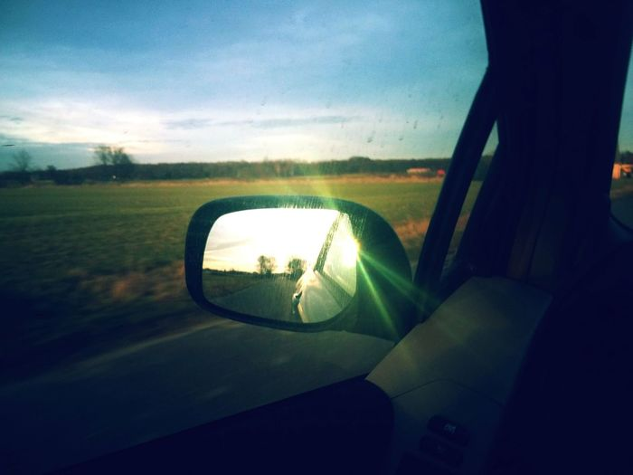 People And Places Transportation Car Land Vehicle Mode Of Transport Road Side-view Mirror Landscape Auto Post Production Filter Sky Car Interior Reflection Street Cloud Sunset Vehicle Interior Road Trip Sunbeam Dividing Line Cloud - Sky Field