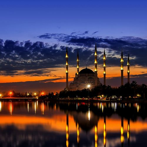 Reflection Of Illuminated Mosque In Water