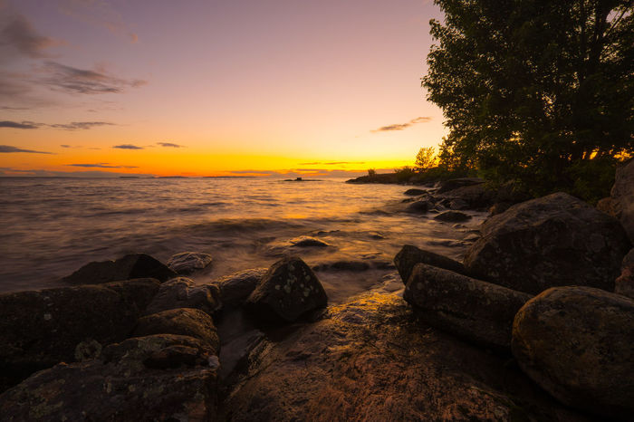 Beautiful sunset over Lake Nipissing. FUJIFILM X-T1 Lake Nipissing North Bay Ontario Beach Beauty In Nature Day Evening Sky Horizon Over Water Idyllic Nature No People Orange Color Outdoors Rock - Object Scenics Sea Shore Sky Sunset Tranquil Scene Tranquility Tree Water