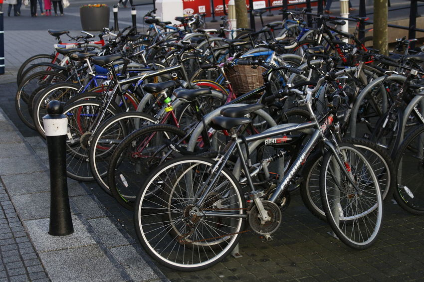 Bicycle Bicycle Parking Bicycle Rack Bicycle Shop Bicycles City City Life Cityscape Close-up Cycling Eco Tourism Land Vehicle Mode Of Transport No People Outdoors Parking Parking Area Parking Lot Pedal Stationary Transport Transportation Transportation Tyres Wheel