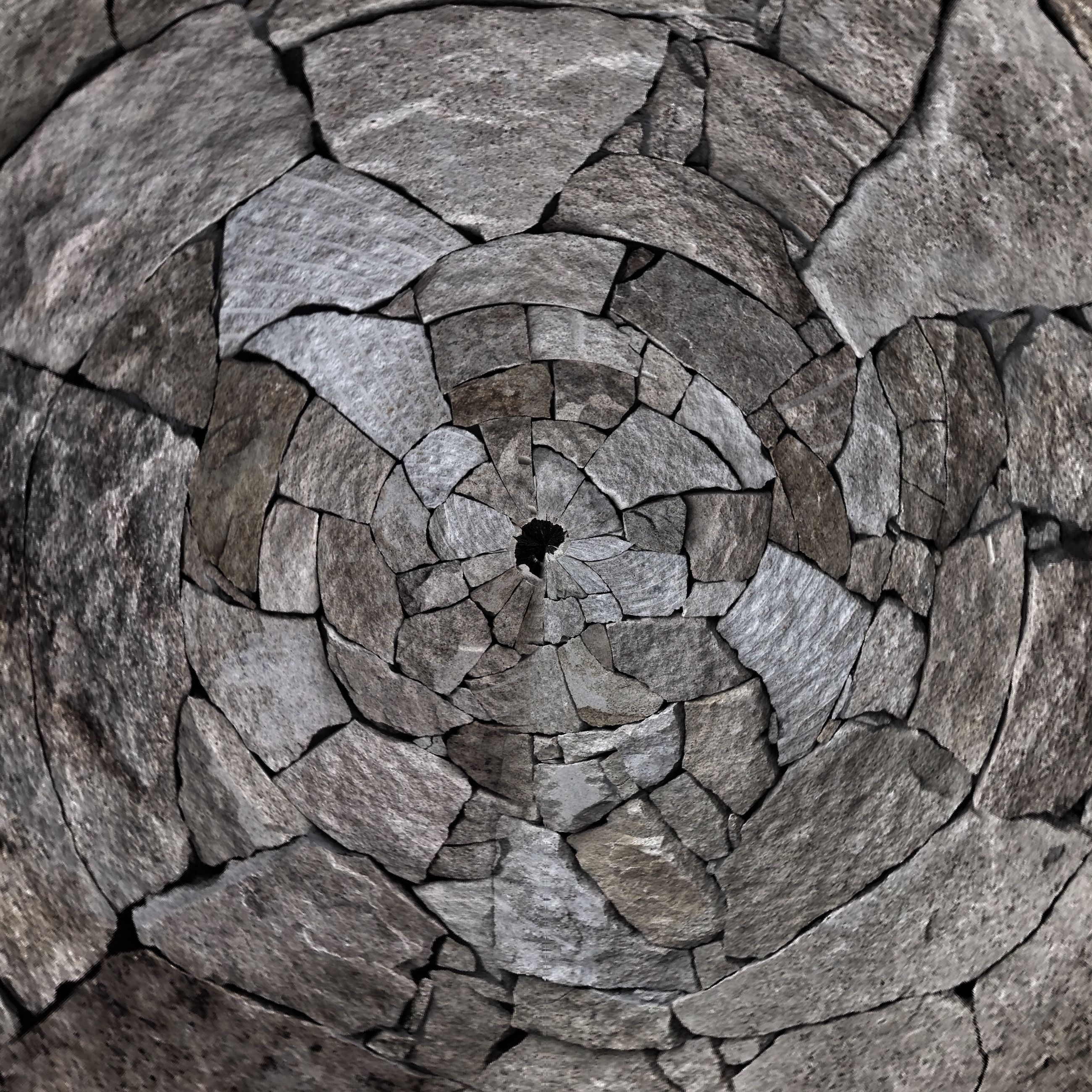 full frame, backgrounds, textured, pattern, cracked, rough, stone wall, natural pattern, rock - object, cobblestone, high angle view, close-up, stone, stone - object, day, no people, outdoors, stone material, nature, detail