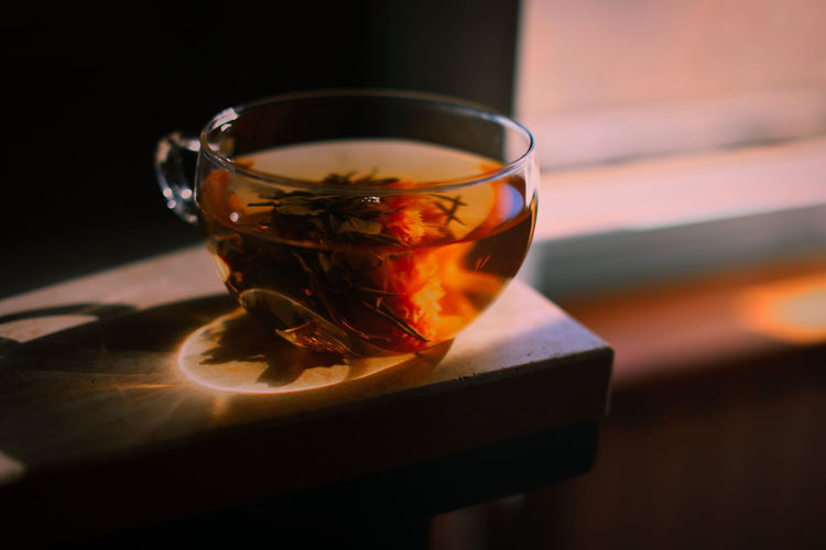 Close-up of herbal tea in cup on table