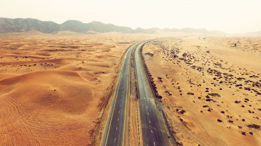 Lost In The Landscape Landscape Road Transportation Sand Desert Mountain Arid Climate Nature Outdoors Scenics No People Sky Day Sand Dune Beauty In Nature Clear Sky