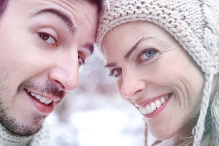 Portrait of smiling couple during winter