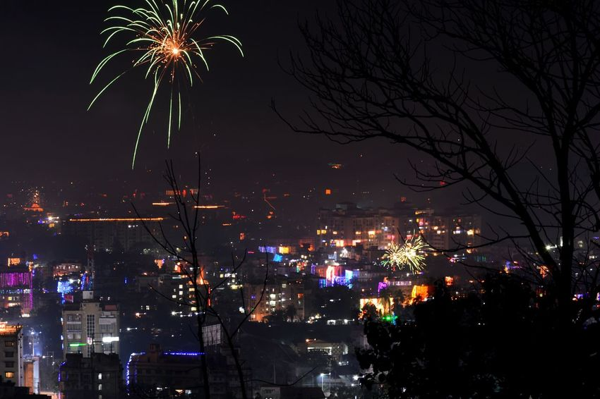Night Firework Display Celebration Firework - Man Made Object Illuminated Arts Culture And Entertainment Outdoors Tree No People City Sky Multi Colored Cityscape