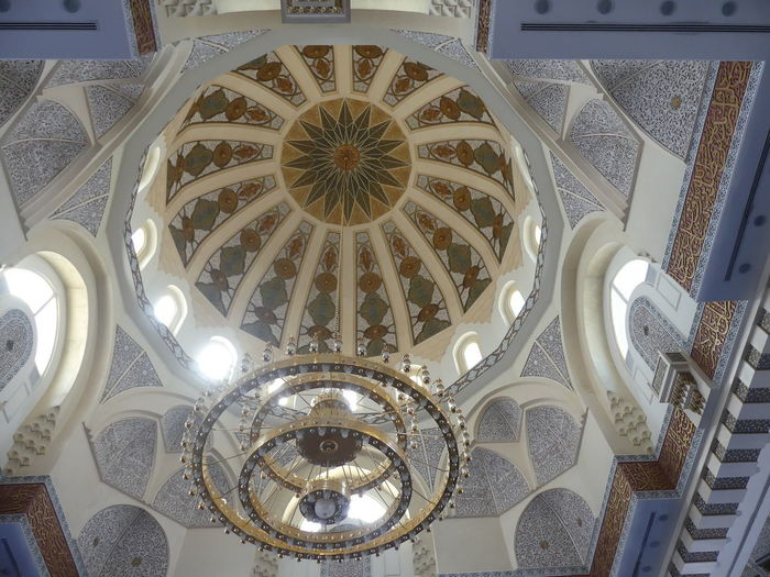 Ornate Decoration of the Mosque Dome in front of The Royal Palace, Dubai, United Arab Emirates 2019 Dubai UAE 2019 Mosque Dome Ornate Decoration Chandelier Low Angle View Ceiling No People Religion Spirituality Belief Place Of Worship Islamic Art Decoration Hanging Lighting Equipment Ornate Pattern Islam Islamic Architecture Full Frame Composition Indoor Photography