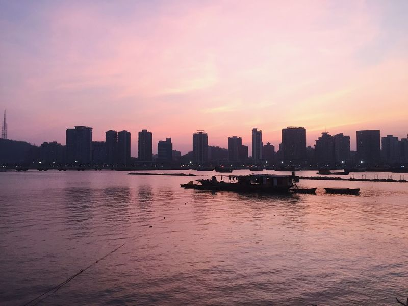 Fading sunset Sunset Skyscraper Architecture Building Exterior Water Built Structure City Waterfront Urban Skyline Sky River Nautical Vessel Outdoors Cityscape Transportation Modern No People Nature Scenics Beauty In Nature