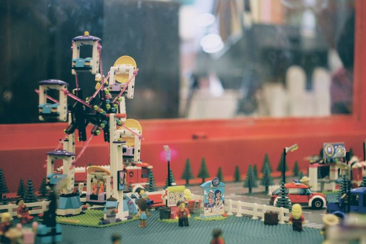 Focus On Foreground Human Representation Representation Figurine  Art And Craft Architecture Incidental People Day Creativity Outdoors Male Likeness Transportation Mode Of Transportation Red Large Group Of Objects Built Structure Building Exterior Car Craft