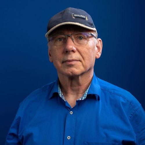Senior man against blue background