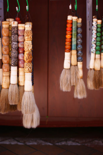 Close-up of multi colored brushes on table