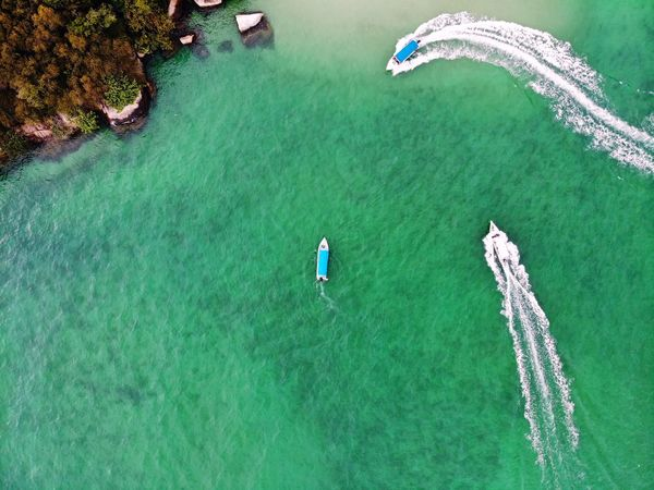 Aerial shot of boats moving through a sea View Holiday Travel Travel Destinations Outdoor Nature Sea Beauty Aerial Shot Aerial Photography Dronephotography Beautiful EyeEm Selects Getty Images EyeEm Best Shots Malaysia Boat Water Full Length Child High Angle View Drone  Grass Green Color Plant Shore Beach Water Sport Moored Wave