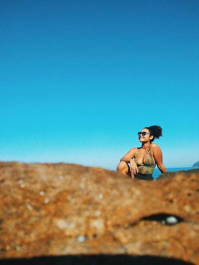 EyeEm Selects Clear Sky Sitting Blue Portrait Beautiful Woman Summer Women Fashion Beauty Sunglasses Sand Dune Namib Desert Haute Couture Ceremonial Make-up Arid Landscape Cocktail Dress Arid Leopard Arid Climate Jewelry Posing Atmospheric Marram Grass Fashion Industry Desert Thoughtful Fashion Model Artist's Model Frizzy