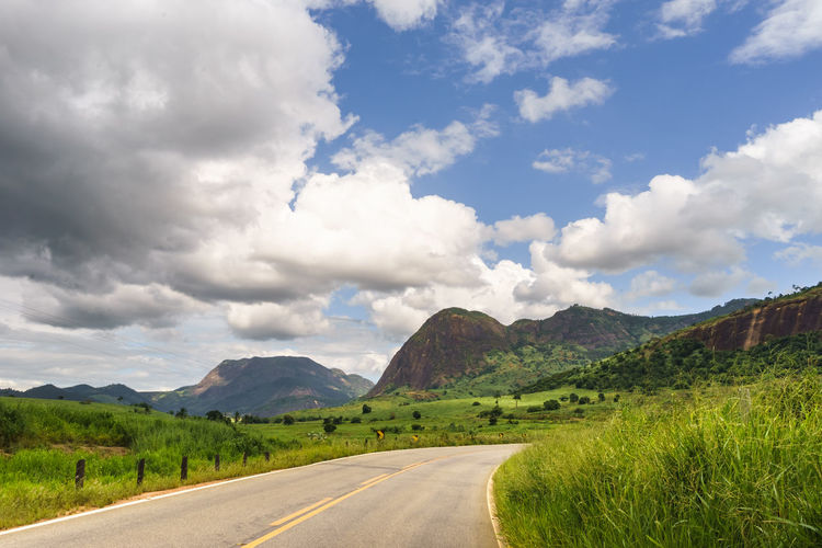 Road and landscapes of Brazil. Road Beauty In Nature Cloud - Sky Day Direction Environment Grass Green Color Landscape Long Mountain Mountain Range Nature No People Non-urban Scene Outdoors Plant Road Scenics - Nature Sky The Way Forward Tranquil Scene Tranquility Transportation