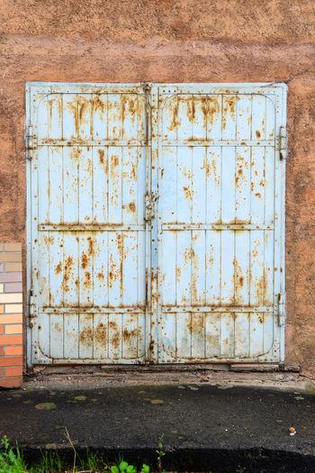 Old rusty door of abandoned building
