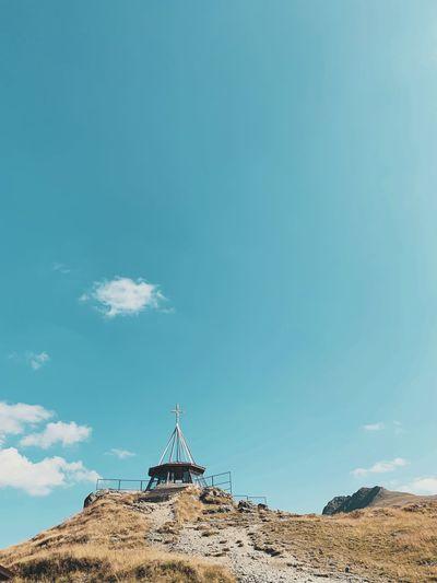 Built structure on land against blue sky