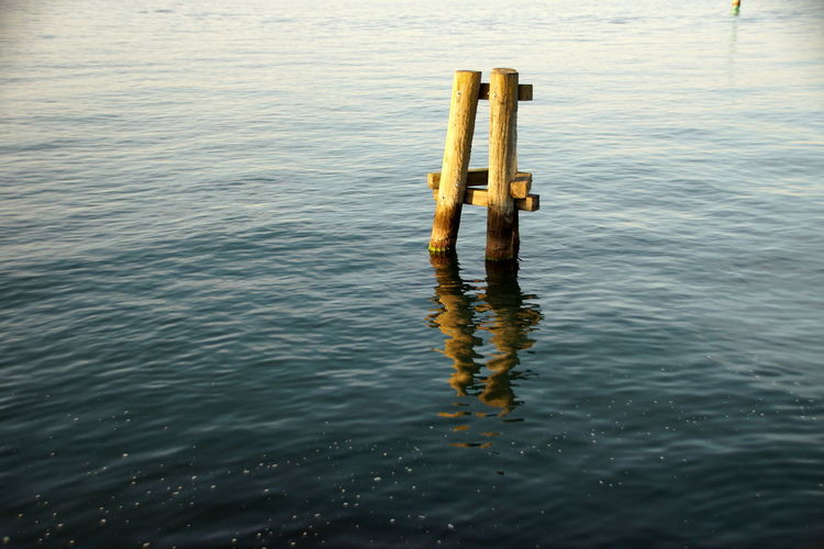 High angle view of wooden post in lake