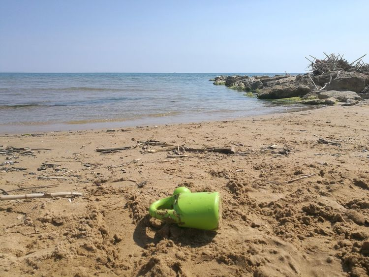Beach Sand Green Color Sea Water Horizon Over Water No People Vacations Tranquility Nature Sky Day Beauty In Nature Sand Pail And Shovel Outdoors Mare Spiaggia Ricordi Di Un'estate Nostalgia Sicilia Sicily Live For The Story