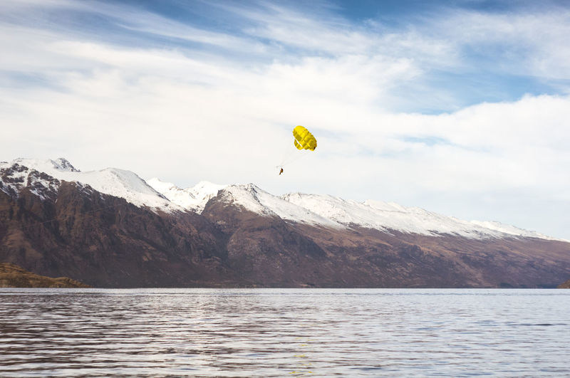 Distant Person Paragliding Over Wakatipu Lake