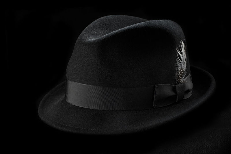 Close up of hat over black background