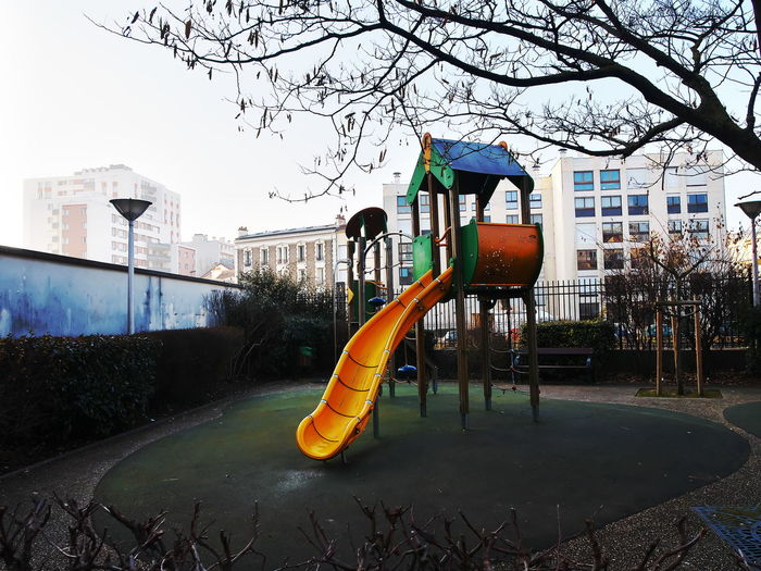 View of playground against clear sky