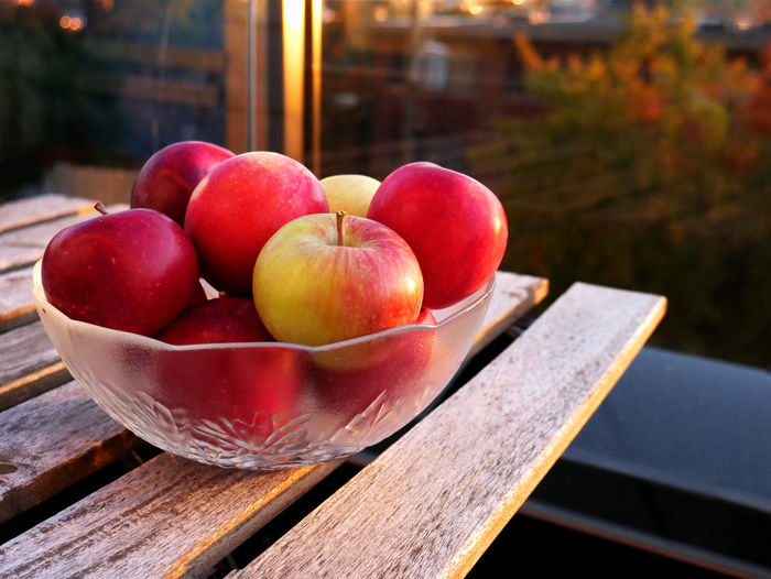 Close-up of apples in container on table