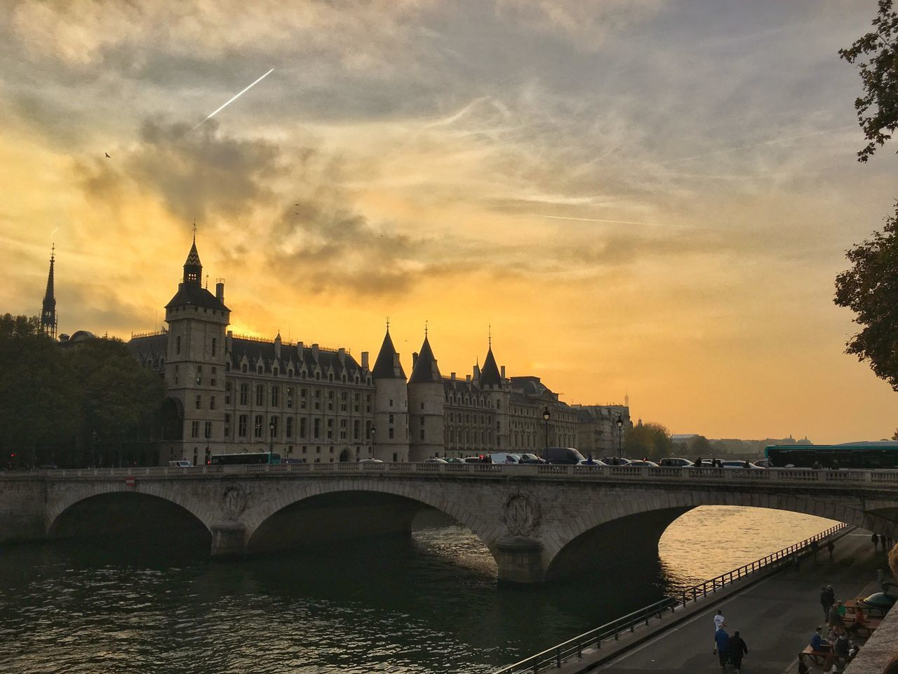 architecture, built structure, bridge - man made structure, river, connection, sky, sunset, travel destinations, building exterior, water, arch, tourism, city, cloud - sky, outdoors, tree, day, no people, nature