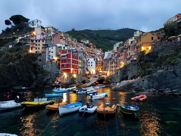 Riomaggiore on dusk from the harbour, Cinque Terre, Italy Travel Destinations Architecture Building Exterior Reflection Nautical Vessel Dusk Dramatic Sky Outdoors Water Cityscape Illuminated Boats Harbour Marina Italy Cinque Terre EyeEmNewHere