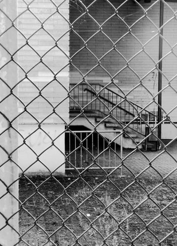 Tristesse Architecture Building Exterior Built Structure Chainlink Fence City Close-up Day Deserted Full Frame Metal No People Outdoors Protection Safety Security