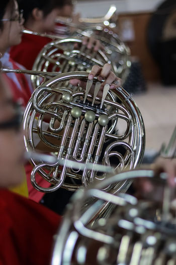Music Instrument French horn, French Player. Music Musical Instrument Arts Culture And Entertainment Artist Musician Brass Instrument  Performance Incidental People Playing Men Holding Brass Selective Focus Trumpet Parade Musical Equipment Close-up Real People Skill  People Marching Band Orchestra Uniform