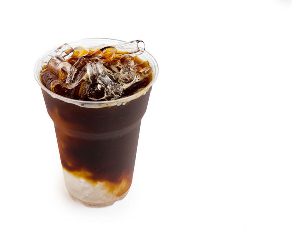 Closeup ice of americano on white background Americano Brown Close-up Cola Drink Drinking Glass Ice Ice Tea White Background White Background Beauty Sky Plant Part