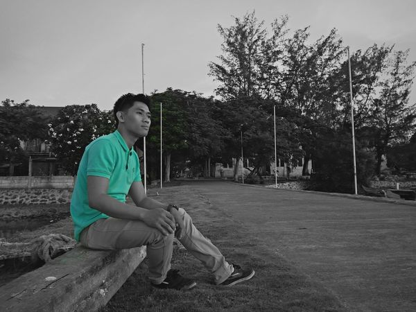 Sitting One Person Adult People Tree Adults Only Young Adult One Man Only Outdoors Sky Sport Only Men Full Length One Young Man Only Day Nature Blackandwhite Photography Color Pop!🎨 Ugly Green Shirt Polo Shirt  Dramatic Edit EyeEm Selects Sommergefühle EyeEmNewHere