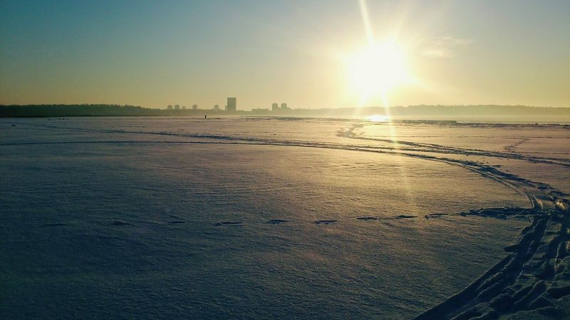 Sunset Beach Sunlight Sun Sea Outdoors Scenics Sky Cold Temperature Day Landscape Tranquility Winter Trails Snow EyeEmNewHere Snowy Field Trails In Snow