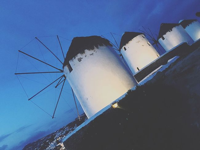 Four Of A Kind - The Windmills of Myconos @ night   Night Photography Cityscape Diagonal Perspective Travel Destinations Discover Myconos Discover Greece Greek Islands Traditional Architecture Aegean Islands Blue Hour IPhoneography Mobile Photography Cycladic Architecture