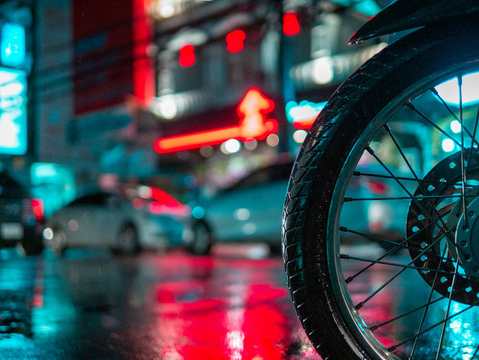 Close-up of wet bicycle on road in city